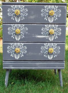 like the stenciling, could live without the drawer pulls