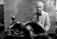 Henry Moore next to one of his artworks