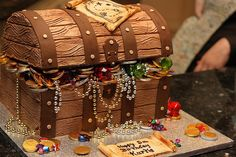 treasure chest cake.  Love this idea, but not sure if it the best choice since it will be a pain to cut.