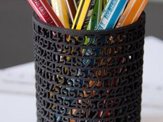 Whoa. This pencil holder is made of the first 546 digits of pi.