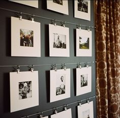 Ikea curtain rod and unframed photos.  simple photo gallery wall.