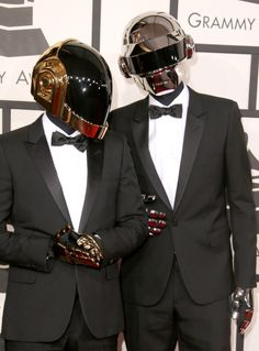 Daft Punk arrive at the 56th Annual GRAMMY Awards on Jan. 26 in Los Angeles