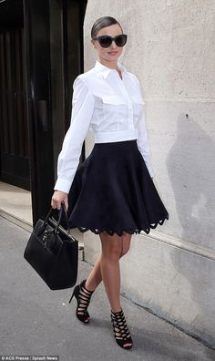 Business chic: The 32-year-old beauty dressed her statement skirt down with office-appropr...