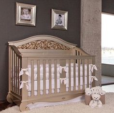 Elegant nursery with charcoal gray nursery walls with ivory and gold baby crib