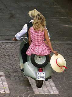 couple on vespa in Asti