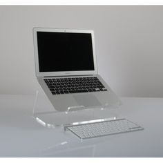 A sturdy acrylic riser that can effectively support MacBooks & other laptops at an ergonomic angle; whilst also creating ample storage space for external keyboards, papers, etc. This stand has an integrated