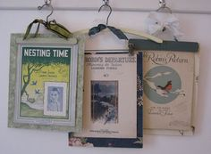 hanging picture frames from old wooden pants hangers, great for sheet music