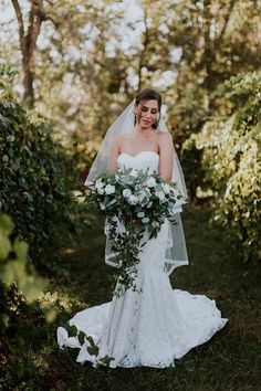 Stunning garden style bouquet with an abundance of greenery by Design House Weddings.
