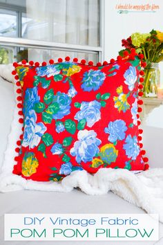 Vintage Fabric Pom Pom Pillow   Make this cute, envelope, pom pom pillow with this simple-to-follow tutorial (she used a vintage Joan Kessler fabric, but any fabric will work!).