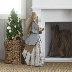 Invite a peaceful setting to your home this season with our Angel with Dove Yard Art. Crafted from wood and iron, this folk art is quite detailed—from her yarn hair and jute bow, to her hand-painted dress and wings. With a sturdy wood base, this angel would look great indoors next to a fireplace or in an entryway, or outdoors under a covered space. She looks angelic on her own and even more wonderful paired with another.