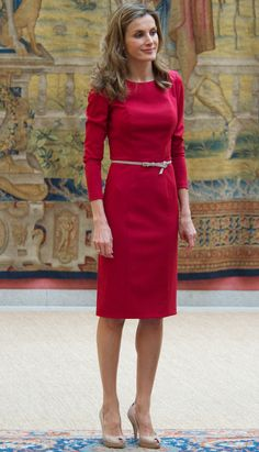 Belt It from Queen Letizia of Spain's Best Looks  One of Letizia's favorite looks is a solid colored calf-length dress belted at the middle and worn with nude heels. We adore this shade of red on her.