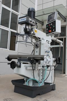 drilling milling machine is with axis is automatic feed through gear box box is gear drive, quill can feed manually. is movable forward and backward, and swivel 180 degrees. Milling Machine, Machine Tools, Johnny Bravo, Gear Drive, Lathe, 3d Printer, Drill, Industrial, Accessories