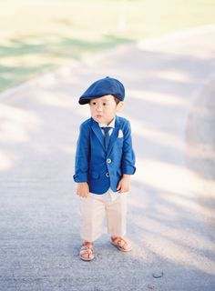 Adorable little ring bearer: http://www.stylemepretty.com/2016/05/12/simple-elegant-blush-wedding/ | Photography: The Great Romance - http://thegreatromancephoto.com/