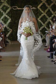 Strapless mermaid Oscar de la Renta wedding gown and veil with floral appliqué