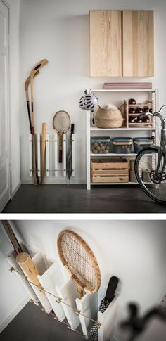 An IKEA MOSSLANDA hack using picture ledges secured vertically with tennis rackets, hockey sticks, baseball bats and umbrellas stored upright #umbrellarackideas #tennishacks #baseballhacks