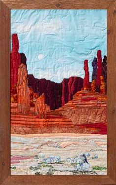 Artist Jeanine Malaney display the fabric art landscape quilt Monument Valley Shepherd a sheep shepherd watching over his herd with a background of rock spirals. Monument Valley, Nancy Zieman, Tim Holtz, Southwestern Quilts, Southwest Decor, Watercolor Quilt, Landscape Art Quilts, Quilted Wall Hangings, Applique Quilts