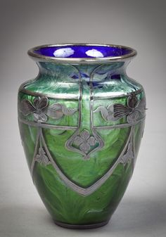 Loetz glass vase with sterling silver overlay circa. 1900.