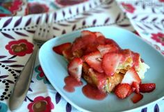 Lemon-flavored sweetened cream cheese spread onto croissants and baked like French toast, topped with fresh strawberries and fresh strawberry sauce.