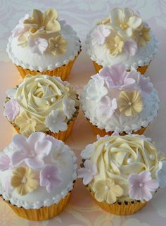 Enchantingly pretty and complete delicious looking Vanilla Buttermilk Cupcakes with Raspberry Filling, Frosted with Baileys and White Chocolate Buttercream. #cupcakes #wedding #cake #spring #Easter #flowers #roses #pink #yellow #food #dessert #decorated #baking