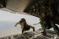 airbornebear:  U.S. Army Green Berets from the 7th Special Forces Group jump out of a C-130H3 Hercules for Emerald Warrior at Hurlburt Field, Fla., April 22, 2015. Emerald Warrior is the Department of Defense's only irregular warfare exercise, allowing joint and combined partners to train together and prepare for real-world contingency operations.U.S. Air Force photo by Tech. Sgt. Joshua J. Garcia /Released