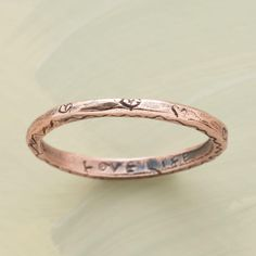 """ROSE GOLD VITALITY RING--Encircled with hearts, our exclusive 14kt rose gold vitality ring is inscribed within: """"love life, be thankful."""" Handmade in the USA by Jes MaHarry. Whole and half sizes 5 to 11-1/2."""