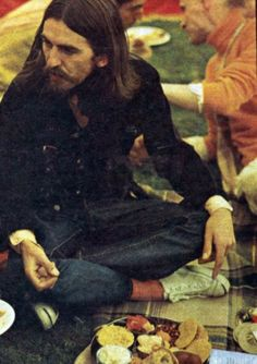 """August 28, 1969 George Harrison at the launch for the single """"Hare Krishna Mantra"""" by the Radha Krsna Temple. The party which was held at a beautiful estate featured vegetarian dishes for the guests who attended."""
