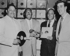 """From left, record store owner John Dolphin, R&B saxophonists Earl Bostic and Joe Houston, and DJ Dick """"Huggy Boy"""" Hugg at Dolphin's of Hollywood, circa 1952.(Michael Ochs Archives ) Rudy Ray Moore, Jelly Roll Morton, First Class Hotel, Hattie Mcdaniel, Apollo Theater, East Los Angeles, Thelonious Monk, Kareem Abdul Jabbar, Duke Ellington"""