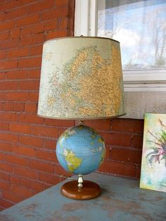 Old Basket used as storage on wall     Old Dresser used as kitchen island     Old decanter bottles made into light fixtures     Globe turn...