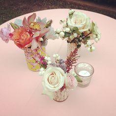 White roses, cymbidium orchids, heather, dusty miller, snowberries