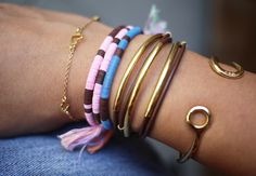 a fun, simple DIY bracelet project made using plastic sequins or vinyl heishi beads and some embroidery floss