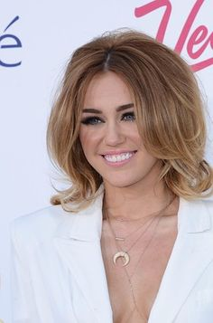 Miley Cyrus has a voluminous short haircut. I wish I could do this but my hair is so thick and it gets really heavy.