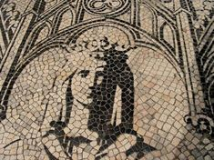 Portuguese pavement: image of the seal of the University of Coimbra, in Portugal, featuring Wisdom.