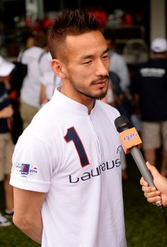 Hidetoshi Nakata Photos - Hidetoshi Nakata is interviewed during the Laureus All Stars Unity Cup ahead of the 2014 Laureus World Sports Awards at Royal Selangor Club on March 25, 2014 in Kuala Lumpur, Malaysia. - Laureus All Stars Unity Cup