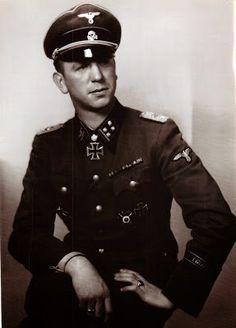"""SS-Brigadeführer und Generalmajor der Waffen-SS Kurt """"Panzermeyer"""" MEYER (23 Dec 1910 – 23 Dec 1961) convicted of war crimes for the Ardenne Abbey massacre. Knight's Cross on 18 May 1941 as SS-Sturmbannführer and commander of SS-Aufklärungs-Abteilung """"Leibstandarte SS AH""""; 195th Oak Leaves on 23 Feb 1943 as SS-Obersturmbannführer and commander of SS-Aufklärungs-Abteilung """"Leibstandarte SS AH""""; 91st Swords on 27 Aug 1944 as SS-Standartenführer and commander of the 12 SS-Panzer-Div…"""