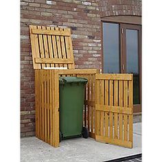 Wheelie bin store - could use pallets. I am so going to make one of these, could even hang planters off the side.
