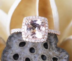 A lovely natural Morganite Ring in your choice of 14K White, Yellow or Rose Gold. The engagement ring has a natural 7mm Cushion Cut Morganite at its