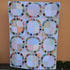 Single Girl quilt. Scrappy DS fabrics and low volume backgrounds. Love!
