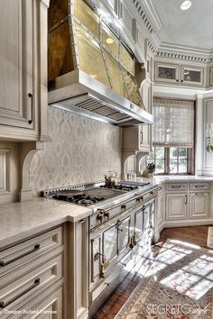 Segreto Secrets - Design Chic Great kitchen and love the stainless hood!