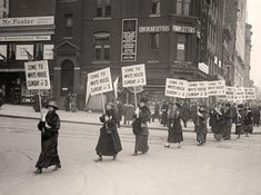Here for your perusal is a beautiful photo of Woman Suffrage. Marching With Inv. Signs. It was created in 1917 by Harris & Ewing.