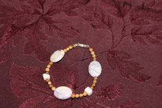 Large Purple and White Oval Stones with Small Brown Speckled Round Stones and White Mother-Of-Pearl Squares Bracelet