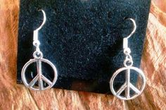 Beautiful silvertone peace sign earrings. These make excellent Christmas gifts. Very affordable, but sure to be a favorite! - $6.00