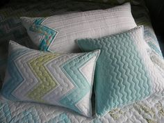 Love the quilting and designs on these pillows by Jenny Pedigo of Sew Kind of Wonderful
