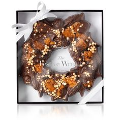 Inspired by one of the absolute classic flavour combinations of mellow 50% cocoa milk chocolate working in perfect harmony with nibbly cookies and hand cut florentines, our Festive Wreath is perfect for slicing and sharing with family and friends. #hotelchocolat #hcdreamhamper