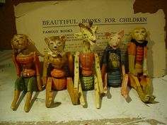 """Joint venture, Animals, 6"""" tall, just laughing it up. We loved doing them.  Wood bodies, clay molded heads.  You can tell they bring joy with them, look at those faces."""