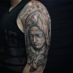 The Virgin Mary tattoos are ones of the Christian tattoos that are very popular and have been common for a long period of time. Rose Tattoos For Men, Tattoos For Guys, Tattoo Designs And Meanings, Tattoos With Meaning, Maria Tattoo, Religious Tattoos For Men, Tattoo Arm Mann, Mother Mary Tattoos, Fist Tattoo