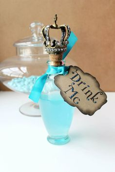 "Alice in Wonderland Wedding ""Drink Me"" Party Tags- Kraft/Turquoise- Set of 12. $14.95, via Etsy."