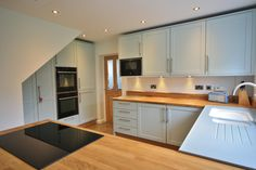Mixed Blue and Oak Kitchen design, with solid Oak worktops and a Seamless raised sink area in Corian Aqua. Kitchen Worktop, Kitchen Cabinets, Kitchen Appliances, Kitchens, Corian Sink, Combi Oven, Oak Worktops, Timber Door, Shaker Kitchen