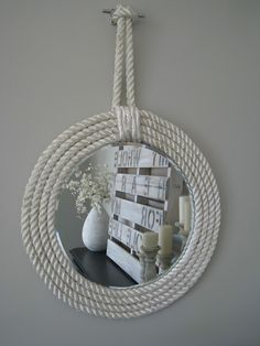 Nautical Rope Mirror:  use the largest mirror charger (you know the thing they normally put centerpieces and candles on at weddings) they were like $8.  I took some sturdy foam board, cut a larger circle around the mirror, and glued the mirror in the center.