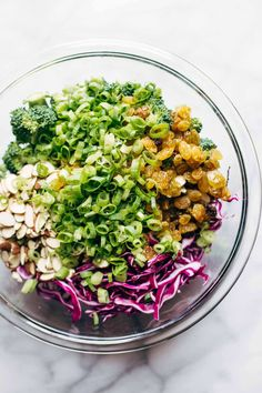 Broccoli Salad with Creamy Almond Dressing CLEAN Broccoli Salad - non-mayo-based vegan goodness! with purple cabbage, raisins, almonds, green onions, and almond butter dressing. Healthy Salads, Healthy Chicken Recipes, Raw Food Recipes, Food Network Recipes, Salad Recipes, Cooking Recipes, Delicious Recipes, Shredded Brussel Sprout Salad, Sprouts Salad