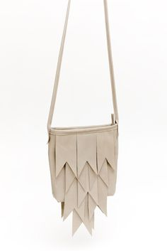 Really interesting isometric style cutout shoulder bag. I dig the pale cream shade. Wear with a simple & laidback/extremely complex outfit.